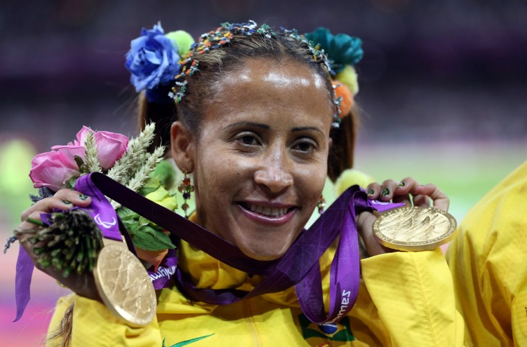 Gold medalist Terezinha Guilhermina of Brazil poses on the podium during the medal ceremony for the Women's 100m T11 Final on day 7 of the London 2012 Paralympic Games at Olympic Stadium on September 5, 2012 in London, England. (Julian Finney/Getty Images)