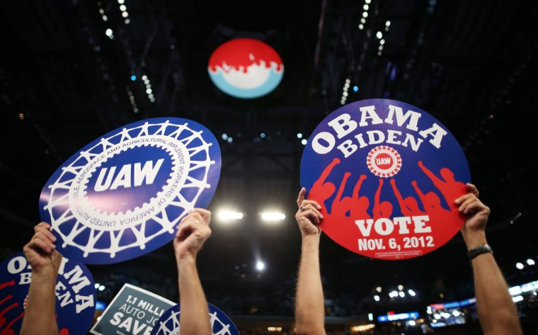 """Attendees hold signs that say """"1.1 Million Auto Jobs Saved"""" and union related signs during day two of the Democratic National Convention at Time Warner Cable Arena on September 5, 2012 in Charlotte, North Carolina. (Chip Somodevilla/Getty Images)"""