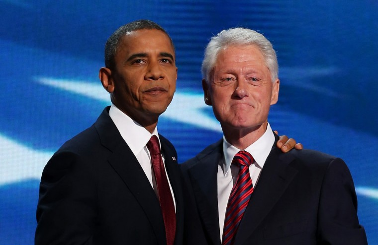 Former U.S. President Bill Clinton stands with Democratic presidential candidate, U.S. President Barack Obama (L) on stage during day two of the Democratic National Convention at Time Warner Cable Arena on September 5, 2012 in Charlotte, North Carolina. (Chip Somodevilla/Getty Images)