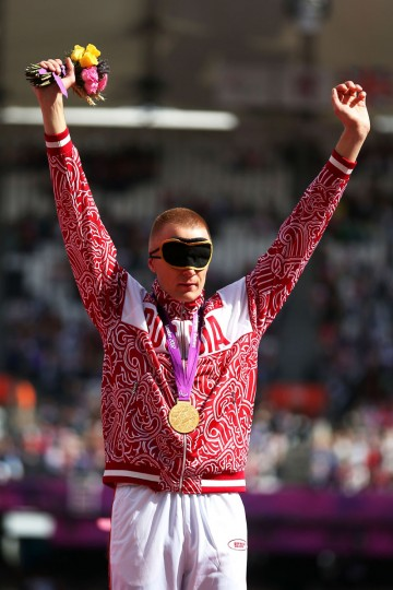 Gold medalist Denis Gulin of Russia pose on the podium during the medal ceremony for the Men's Triple Jump F11 Final on day 8 of the London 2012 Paralympic Games at Olympic Stadium on September 6, 2012 in London, England. (Julian Finney/Getty Images)