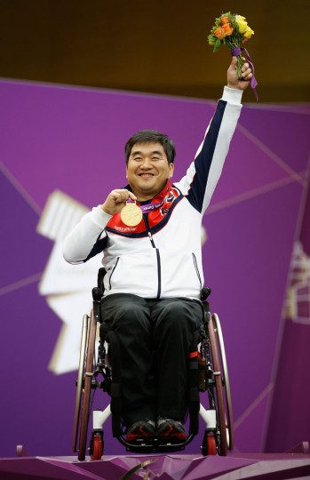 Seakyun Park of the Republic of Korea receives his Gold medal after winning the Mixed P4-50m Pistol-SH1 competition on day 8 of the London 2012 Paralympic Games at The Royal Artillery Barracks on September 6, 2012 in London, England. (Harry Engels/Getty Images)