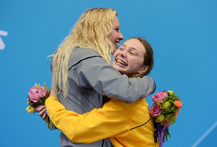 (L-R) Gold medalist Jessica Long of the United States and bronze medalist Maddison Elliott of Australia hug on the podium during the medal ceremony for the Women's 100m Freestyle - S8 final on day 8 of the London 2012 Paralympic Games at Aquatics Centre on September 6, 2012 in London, England. (Gareth Copley/Getty Images)