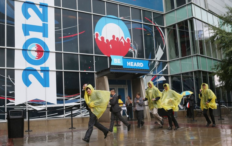 People run for cover from the pouring rain during the final day of the Democratic National Convention outside the Time Warner Cable Arena on September 6, 2012 in Charlotte, North Carolina. The DNC, which concludes today, nominated U.S. President Barack Obama as the Democratic presidential candidate. (Justin Sullivan/Getty Images)