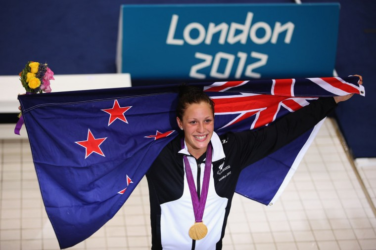 Gold medalist Sophie Pascoe of New Zealand celebrates with her medal after winning the Women's 100m Freestyle - S10 final on day 8 of the London 2012 Paralympic Games at Aquatics Centre on September 6, 2012 in London, England. (Hannah Johnston/Getty Images)