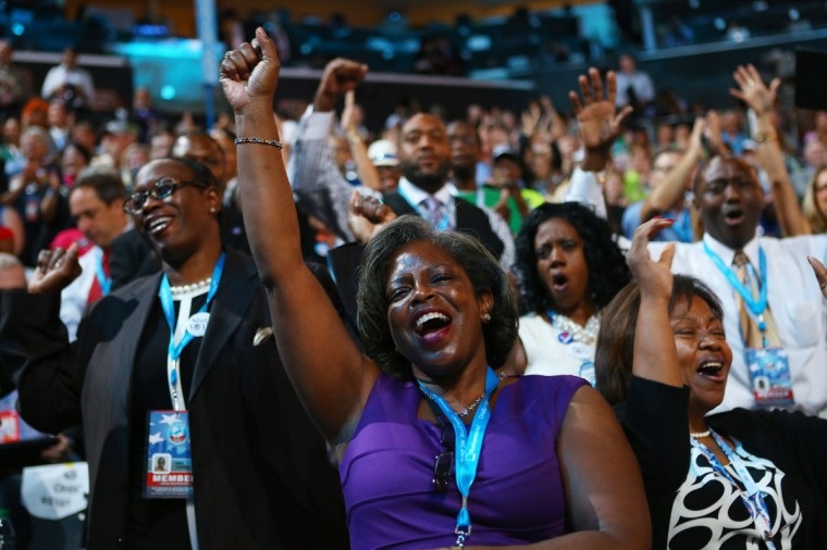 Attendees sing and dance as musician James Taylor performs on stage during the final day of the Democratic National Convention at Time Warner Cable Arena on September 6, 2012 in Charlotte, North Carolina. The DNC, which concludes today, nominated U.S. President Barack Obama as the Democratic presidential candidate. (Joe Raedle/Getty Images)