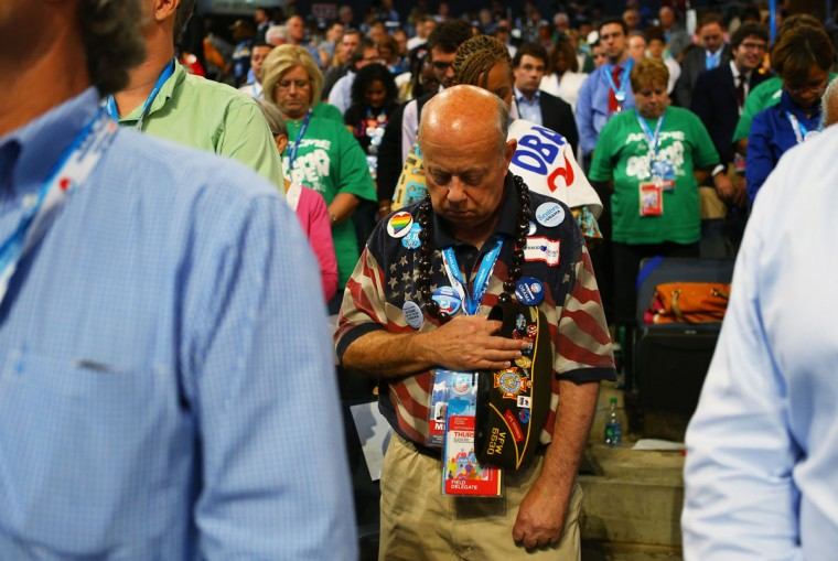 A man bows his head as President, National Latino Evangelical Coalition Rev. Gabriel Salguero gives an invocation during the final day of the Democratic National Convention at Time Warner Cable Arena on September 6, 2012 in Charlotte, North Carolina. The DNC, which concludes today, nominated U.S. President Barack Obama as the Democratic presidential candidate. (Joe Raedle/Getty Images)