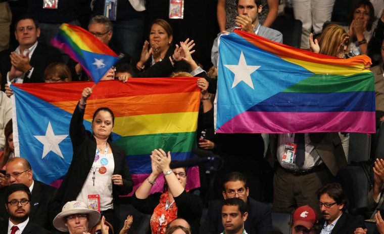 People hold LGBT flags during the final day of the Democratic National Convention at Time Warner Cable Arena on September 6, 2012 in Charlotte, North Carolina. The DNC, which concludes today, nominated U.S. President Barack Obama as the Democratic presidential candidate. (Streeter Lecka/Getty Images)