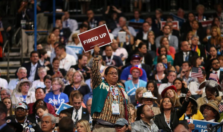 """A man holds a sign that says """"Fired Up"""" as Democratic vice presidential candidate, U.S. Vice President Joe Biden speaks on stage during the final day of the Democratic National Convention at Time Warner Cable Arena on September 6, 2012 in Charlotte, North Carolina. The DNC, which concludes today, nominated U.S. President Barack Obama as the Democratic presidential candidate. (Chip Somodevilla/Getty Images)"""
