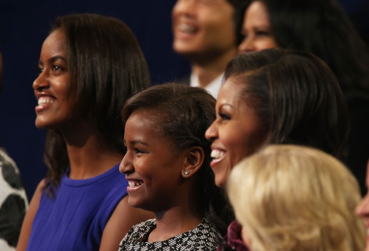 (Left to right) Malia Obama, Sasha Obama, and First lady Michelle Obama watch as Democratic presidential candidate, U.S. President Barack Obama speaks on stage during the final day of the Democratic National Convention at Time Warner Cable Arena on September 6, 2012 in Charlotte, North Carolina. The DNC, which concludes today, nominated U.S. President Barack Obama as the Democratic presidential candidate. (Justin Sullivan/Getty Images)