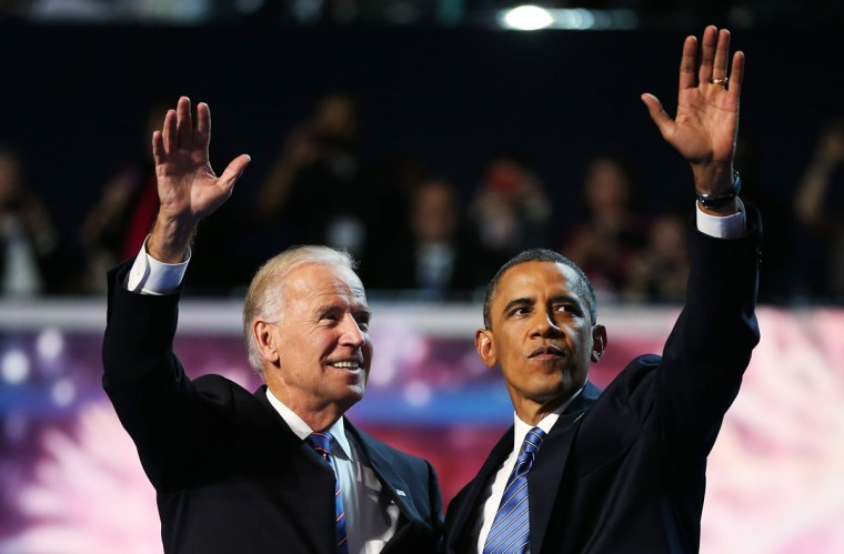 Democratic presidential candidate, U.S. President Barack Obama (R) and Democratic vice presidential candidate, U.S. Vice President Joe Biden wave after accepting the nomination during the final day of the Democratic National Convention at Time Warner Cable Arena on September 6, 2012 in Charlotte, North Carolina. The DNC, which concludes today, nominated U.S. President Barack Obama as the Democratic presidential candidate. (Tom Pennington/Getty Images)