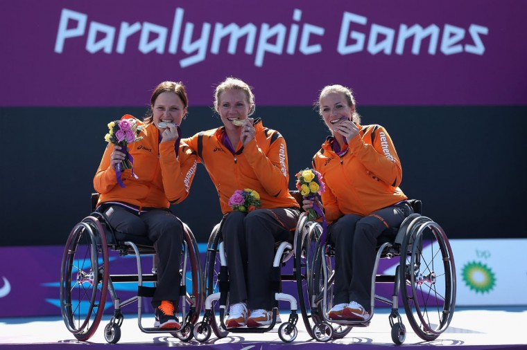 (L-R) Aniek Van Koot of Netherlands with her silver medal, Esther Vergeer of Netherlands with her gold medal and Jiske Griffioen of Netherlands with her bronze medal in the final of the Women's singles match in the Wheelchair Tennis on day 9 of the London 2012 Paralympic Games at Eton Manor on September 7, 2012 in London, England. (Julian Finney/Getty Images)