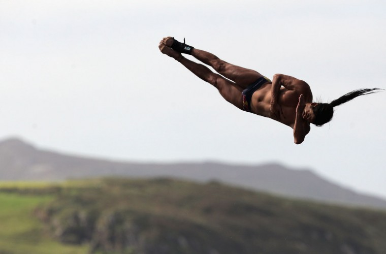 Orlando Duque takes part in the Red Bull Cliff Diving Competition at the Blue Lagoon at Abereiddy near St. David's in Pembrokeshire, Wales. Competitors will dive from a platform 27 meters above the sea and enter the water at 85-90kph during the two-day competition. (Matt Cardy/Getty Images)