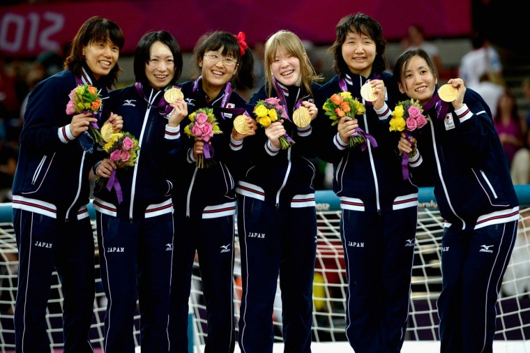 The team of Japan celebrates after winning their Women's Team Goalball Gold Medal match against China on day 9 of the London 2012 Paralympic Games at The Copper Box on September 7, 2012 in London, England. (Dennis Grombkowski/Getty Images)