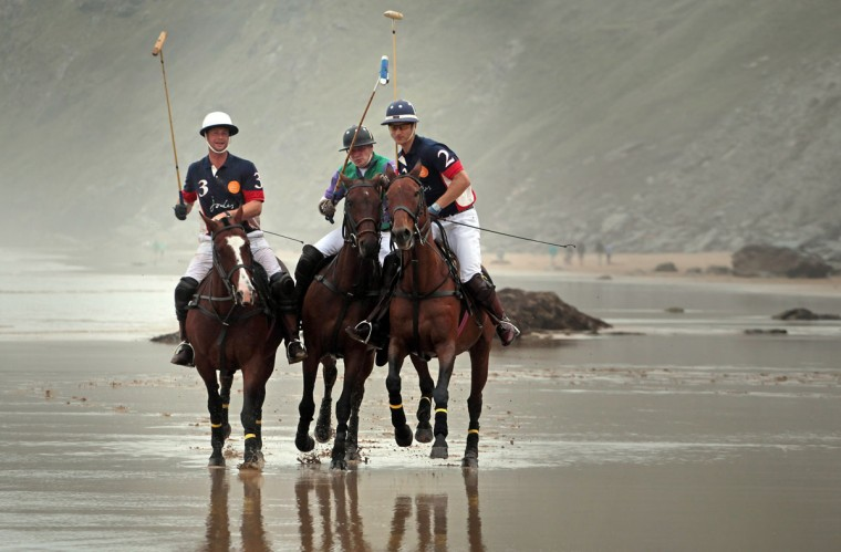 Polo players (L-R) Rob Brockett on his horse Pachu, Andy Burgess on Shriva and Major Ben Marshall on Burris practice on the beach ahead of tomorrow's beach polo event on September 10, 2012 in Newquay, England. Several thousand people are expected to watch the Veuve Cliquot sponsored event, now in its sixth year. (Matt Cardy/Getty Images)