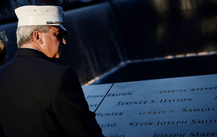 New York City Firefighter Dan Kenny looks out over the South Pool during memorial ceremonies for the eleventh anniversary of the terrorist attacks on lower Manhattan at the World Trade Center site September 11, 2012 in New York City. (Justin Lane-Pool/Getty Images)