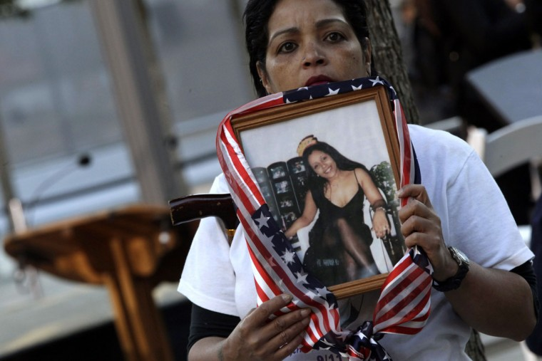 Linda Torrens holds a portrait of her cousin Janine Nicole Gonzalez before the start of the memorial ceremonies for the eleventh anniversary of the terrorist attacks on lower Manhattan at the World Trade Center site September 11, 2012 in New York City. (CMary Altaffera-Pool/Getty Images)