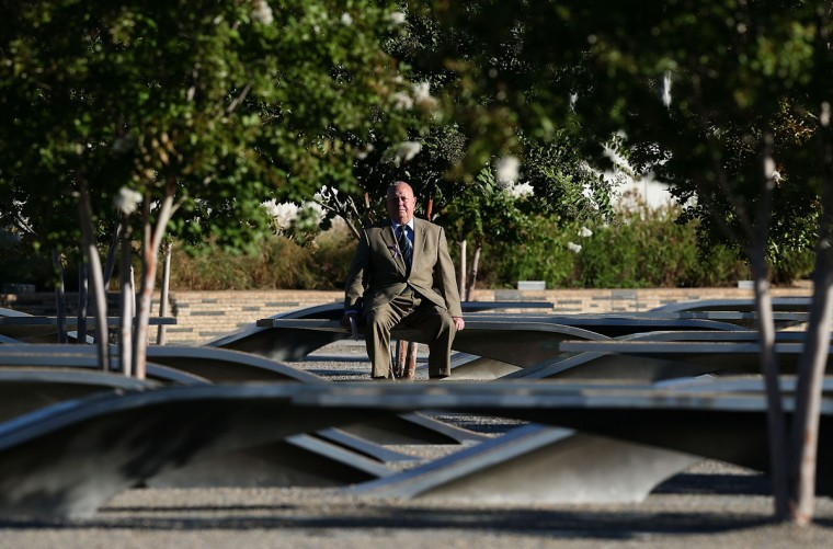 A family member of a victim of the 9/11 visits the Pentagon Memorial before a remembrance ceremony September 11, 2012 in Arlington, Virginia. U.S. President Barack Obama is scheduled to joined staff and family members at the Pentagon to commemorate the eleventh anniversary of the September 11 attacks. (Mark Wilson/Getty Images)