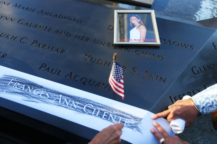 Judy Parisio (R) and Linda Malbrba make a rubbing of their niece's name, Frances Ann Cilente, who died at the World Trade Center, during memorial ceremonies for the eleventh anniversary of the terrorist attacks on lower Manhattan at the World Trade Center site September 11, 2012 in New York City. (Chang W. Lee-Pool/Getty Images)