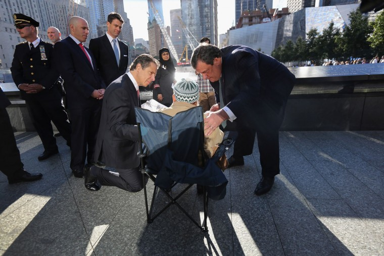 New York Gov. Andrew Cuomo (4th R) and New Jersey Gov. Chris Christie (R), speak with Miah Afsaruddin (2nd R) during ceremonies for the eleventh anniversary of the terrorist attacks on lower Manhattan at the World Trade Center on September 11, 2012 in New York City. (John Moore/Getty Images)