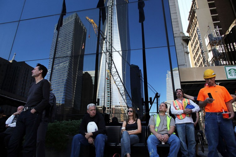 People pause outside of the World Trade Center site on the eleventh anniversary of the terrorist on September 11, 2012 in New York City. New York City and the nation are commemorating the eleventh anniversary of the September 11, 2001 attacks which resulted in the deaths of nearly 3,000 people after two hijacked planes crashed into the World Trade Center, one into the Pentagon in Arlington, Virginia and one crash landed in Shanksville, Pennsylvania. (Spencer Platt/Getty Images)