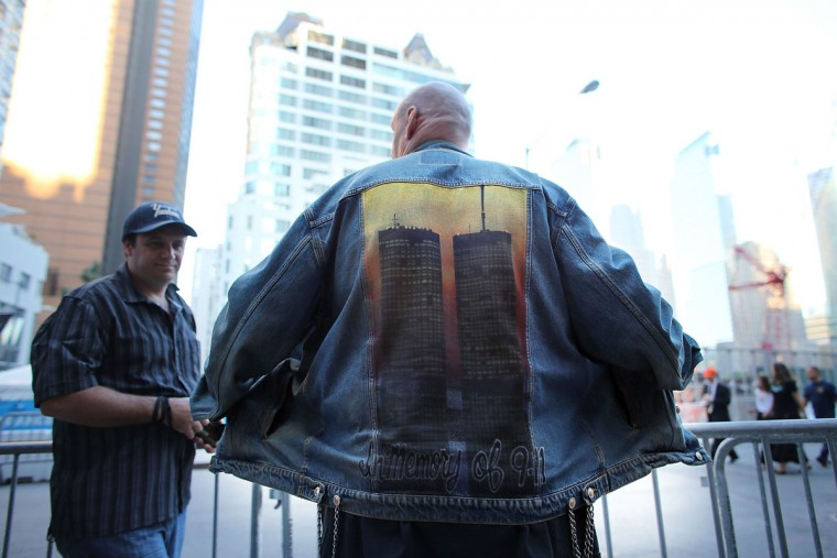David Peters displays a jacket with a painting of the Twin Towers outside of the World Trade Center site on the eleventh anniversary of the terrorist attacks on September 11, 2012 in New York City. (Spencer Platt/Getty Images)