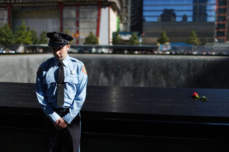 Zachary Ellicott who lost a family member Keith James Burns, observes a moment of silence for US Flight 93 that crashed near Shanksville, Pennsylvania, during memorial ceremonies for the eleventh anniversary of the terrorist attacks on lower Manhattan at the World Trade Center site September 11, 2012 in New York City. (Chang W. Lee-Pool/Getty Images)