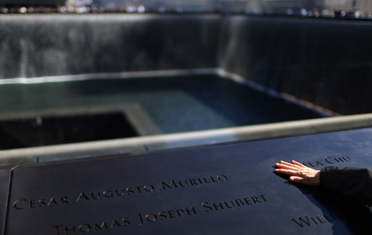 Kio Jung Chu touches her daughter Pamela Chu's engraved name during memorial ceremonies for the eleventh anniversary of the terrorist attacks on lower Manhattan at the World Trade Center site September 11, 2012 in New York City. (Chang W. Lee-Pool/Getty Images)