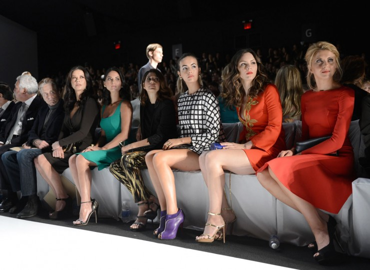 Actor Michael Douglas (from left) and actresses Catherine Zeta-Jones, Olivia Munn, Marisa Tomei, Camilla Belle, Katharine McPhee and Nina Arianda attend the Michael Kors Spring 2013 fashion show during Mercedes-Benz Fashion Week at The Theatre at Lincoln Center in New York City. (Dimitrios Kambouris/Getty Images)