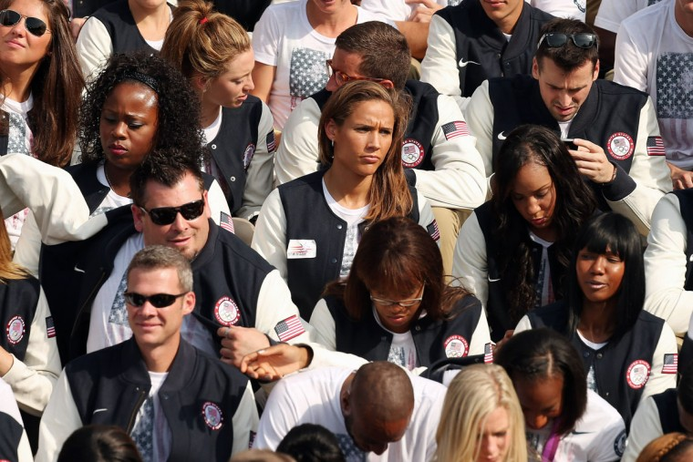 Members of the U.S. Olympic and Paralympic teams, including track runner Lolo Jones (center), gather on the south lawn at the White House. (Chip Somodevilla/Getty Images)
