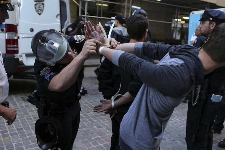 Protesters are arrested during 'Occupy Wall Street' demonstrations on in New York City. The 'Occupy Wall Street' movement, which sparked international protests and sympathy for its critique of the global financial crisis, is commemorating the first anniversary of its earliest protest. (Spencer Platt/Getty Images)