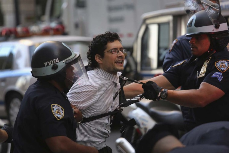 A protester is arrested during the one-year anniversary of the Occupy Wall Street movement in New York City. Occupy protesters converged on the city's financial district to demonstrate what they say is an unfair economic system befefiting corporations and the wealthy instead of ordinary citizens. (John Moore/Getty Images)