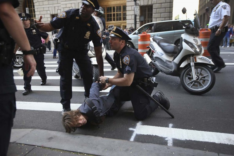 A protester is arrested during the one-year anniversary of the Occupy Wall Street movement in New York City. Occupy protesters converged on the city's financial district to demonstrate what they say is an unfair economic system. (John Moore/Getty Images)