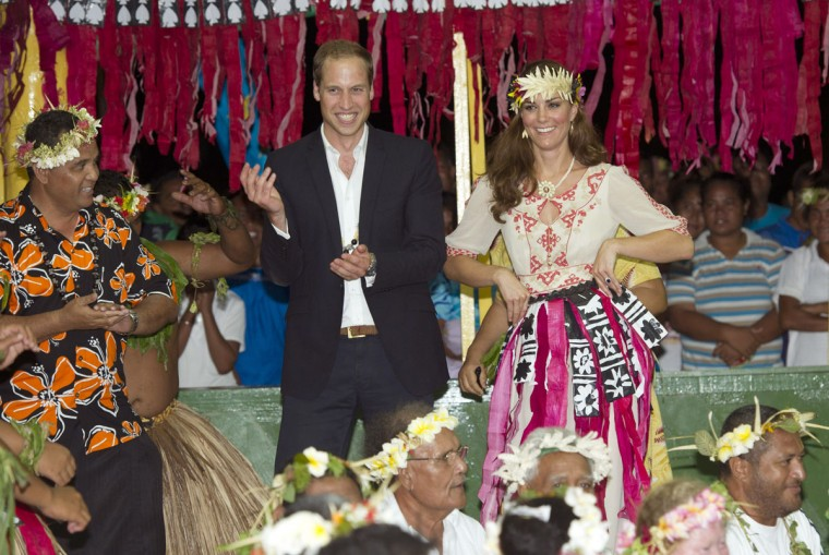 Prince William, Duke of Cambridge and Catherine, Duchess of Cambridge dance with the ladies at the Vaiku Falekaupule for an entertainment programme in Tuvalu. Prince William, Duke of Cambridge and Catherine, Duchess of Cambridge are on a Diamond Jubilee tour representing the Queen taking in Singapore, Malaysia, the Solomon Islands and Tuvalu. (Arthur Edwards/Pool/Getty Images)