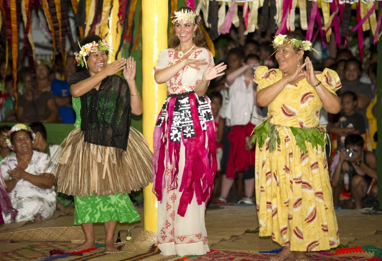 Catherine, Duchess of Cambridge dances with the ladies at the Vaiku Falekaupule for an entertainment programme in Tuvalu. Prince William, Duke of Cambridge and Catherine, Duchess of Cambridge are on a Diamond Jubilee tour representing the Queen taking in Singapore, Malaysia, the Solomon Islands and Tuvalu. (Arthur Edwards/Pool/Getty Images)