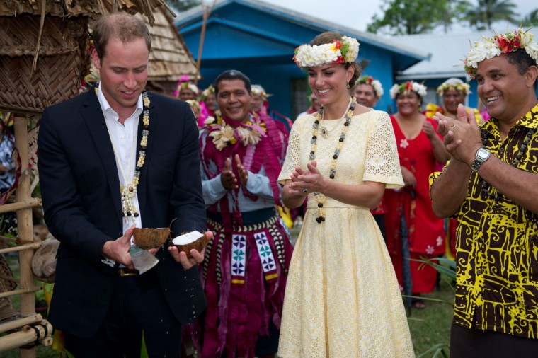 September 18, 2012: Prince William, Duke of Cambridge opens a coconut with a machete as Catherine, Duchess of Cambridge watches in Tuvalu. (Arthur Edwards/Pool/Getty Images)