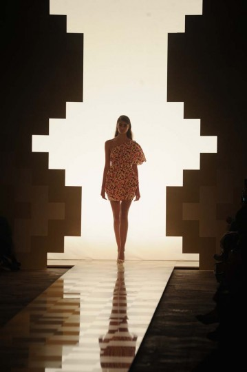 A model walks the runway at the Mila Schon Spring/Summer 2013 fashion show as part of Milan Womenswear Fashion Week in Milan, Italy. (Pier Marco Tacca/Getty Images)