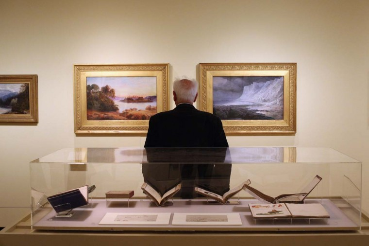 """A man views the works on display at the opening of an exhibition of Edward Lear's artwork in the Ashmolean Museum in Oxford, England. The exhibition """"Edward Lear: 200 Years of Nature and Nonsense"""" celebrates the bicentenary of Lear's birth with a retrospective of over 100 artworks and books spanning his career. (Oli Scarff/Getty Images)"""