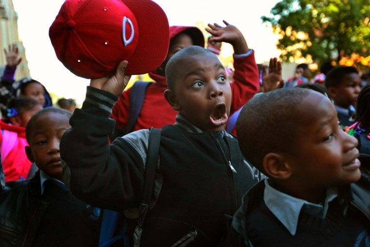 Students at Frazier International Magnet School wait outside before the start of school in Chicago, Illinois. Today was the first day back at school for about 350,000 Chicago public school children after more than 26,000 teachers and support staff walked off of their jobs on September 10 after the Chicago Teachers Union failed to reach an agreement with the city on compensation, benefits and job security. (Scott Olson/Getty Images)
