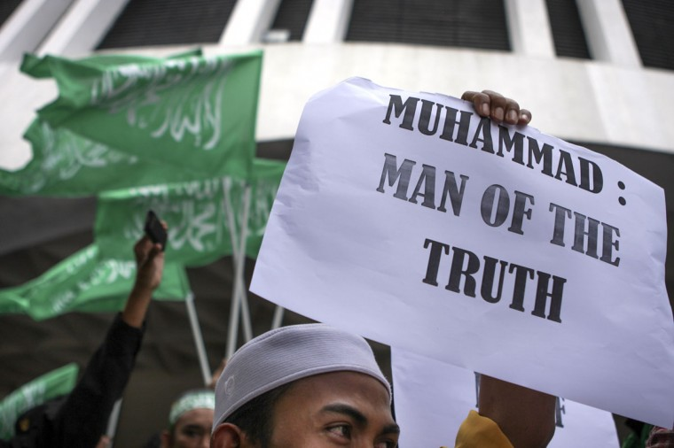 Protester holds a placard saying 'Muhammed: man of truth' during a protest against the anti-Islam film, 'Innocence of Muslims' in front of US embassy in Kuala Lumpur, Malaysia. Muslims across the world continue to protest against America and Israel over the amateur anti Islam film 'Innocence of Muslims.' Despite efforts to encourage peaceful protests, many of these demonstrations have resulted in violence. (Rahman Roslan/Getty Images)