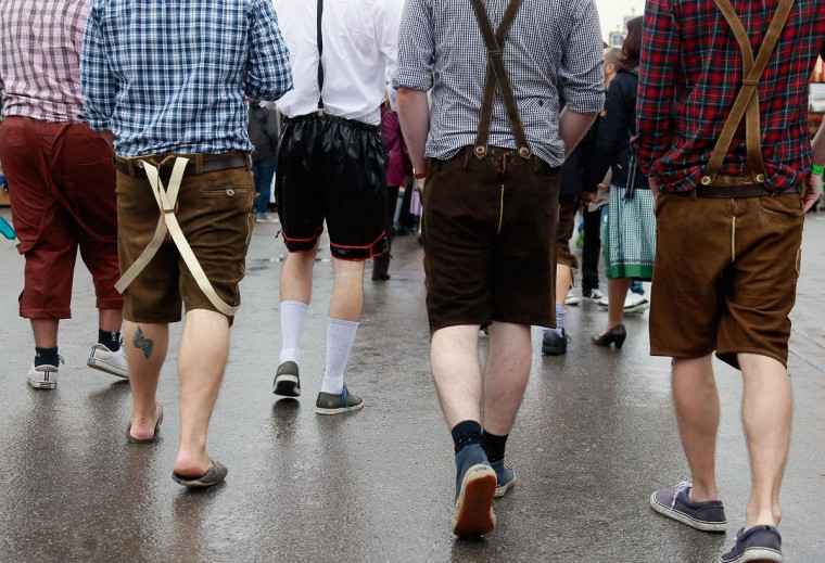 Revelers wearing different types of mock lederhosen arrive for the first day of Oktoberfest in Munich, Germany. The festival runs from September 22 to October 7. (Johannes Simon/Getty Images)