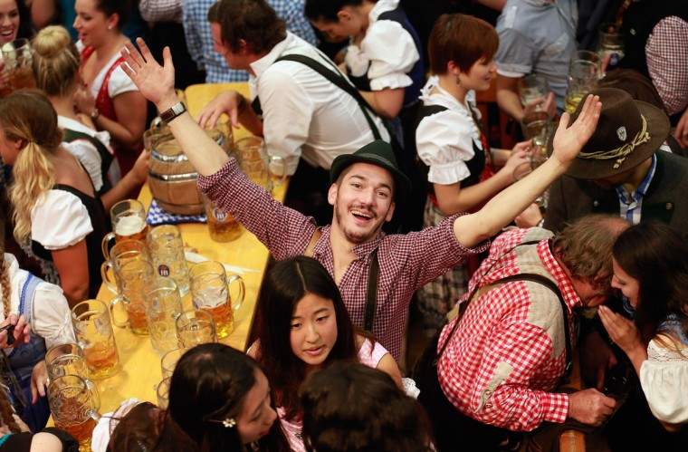 Revelers enjoy drinking beer at the Hofbraeuhaus beer tent on the first day of Oktoberfest in Munich, Germany. The 16-day festival is expected to draw over six million visitors. (Johannes Simon/Getty Images)