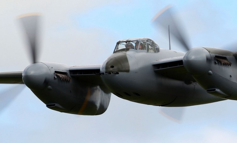 The de Havilland Mosquito KA 114 performs a low pass during an airshow commemorating the completion of its rebuild on September 29 in Ardmore, New Zealand. The plane, restored by Warbird Restorations, is the only flying Mosquito in the world. (Simon Watts/Getty Images)