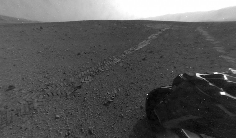 August 29, 2012: Tracks made by the wheels of NASA's Mars rover Curiosity taken by the Curiosity's Hazard Avoidance Camera (Hazcam) are shown after the rover's longest drive on Mars. The drive of about 52 feet (16 meters) during the 22nd Martian day, or sol, of the mission (August 28, 2012), covered more ground than the two previous drives combined. (NASA/JPL-Caltech/HO/AFP/Getty Images)