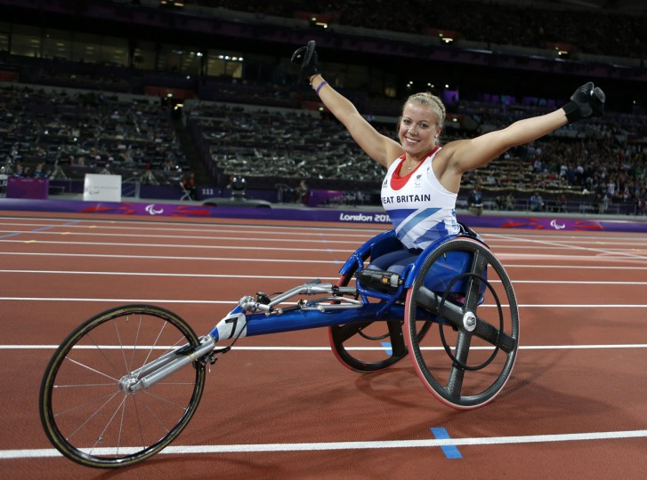 Britain's Hannah Cockroft celebrates after winning the gold medal in the women's 100m T34 final athletics event during the London 2012 Paralympic Games at the Olympic Stadium in east London on August 31, 2012. (Ian Kington/AFP/Getty Images)