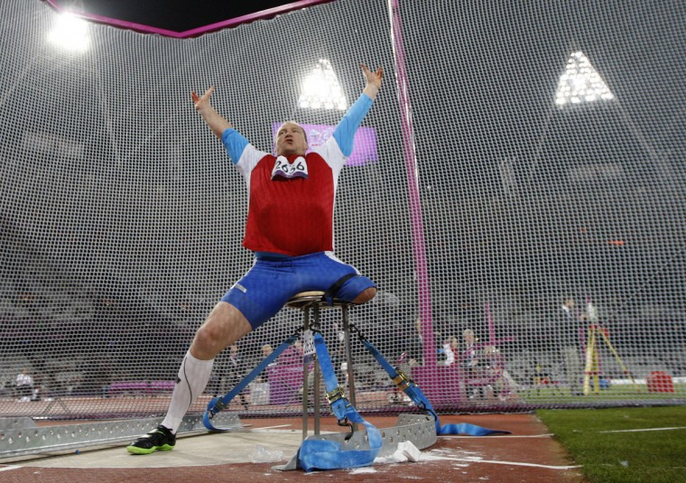 Russia's Alexey Ashapatov cerebrates after breaking the world record with this throw and winning the gold medal in the men's discus throw - F57/58 athletics field event during the London 2012 Paralympic Games at the Olympic Stadium in London on August 31, 2012. (Ian Kington/AFP/Getty Images)