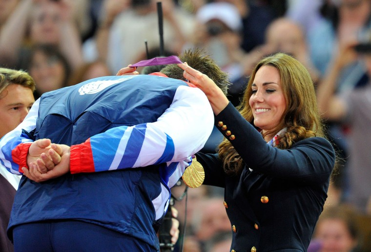 Britain's Catherine, Duchess of Cambridge (R) presents a gold medal to Great Britain's Aled Davies after he won the Men's Discus F42 athletics event during the London 2012 Paralympic Games at the Olympic Stadium in east London, on September 2, 2012. (Glyn Kirk/AFP/Getty Images)