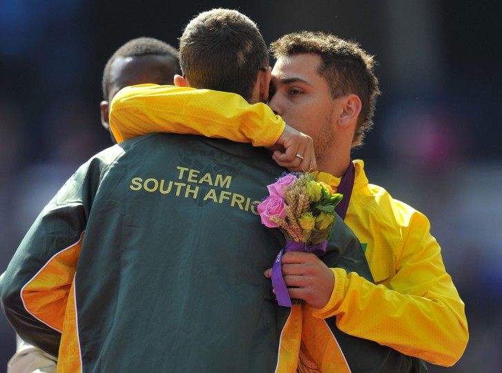 South Africa's silver medallist Oscar Pistorius (L) and Brazil's gold medallist Alan Fonteles Oliveira (R) embrace on the podium during the medal ceremony of the men's 200m T44 athletics event at the London 2012 Paralympic Games on September 3, 2012.