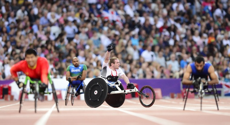 Team GB's Mickey Bushell celebrates after taking the gold medal in the men's 100m T53 at the Paralympic Games at the Olympic Park in east London, on September 3, 2012. (Leon Neal/AFP/Getty Images)