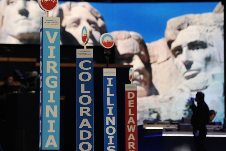 State delegation placards and a projection of U.S. presidents carved into Mt. Rushmore is seen in the Time Warner Cable Arena hours before the start of the Democratic National Convention (DNC), September 4, 2012 in Charlotte, North Carolina. (Robyn Beck/AFP/Getty Images)