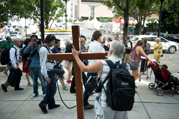 Ken Yarmosh holds a cross outside Charlotte Convention Center September 4, 2012 in Charlotte, North Carolina. (Brendan Smialowski/AFP/Getty Images)